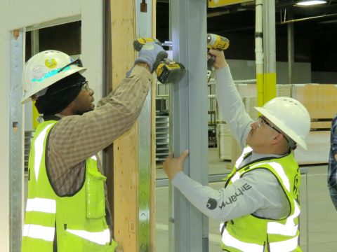 Adolfson & Peterson carpenters learn frame installation from Doorways' experts